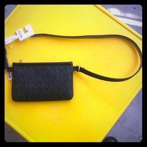 Black Michael Kors belted wallet.